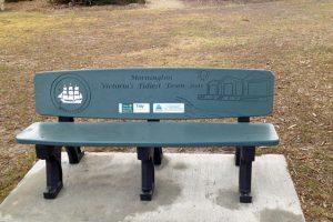 Beachcomber with plaque & text